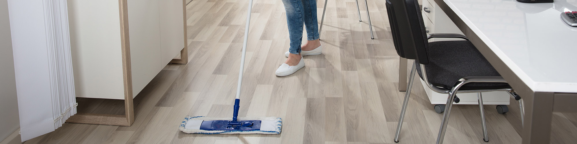 image of woman cleaning a hardwood floor with a mop