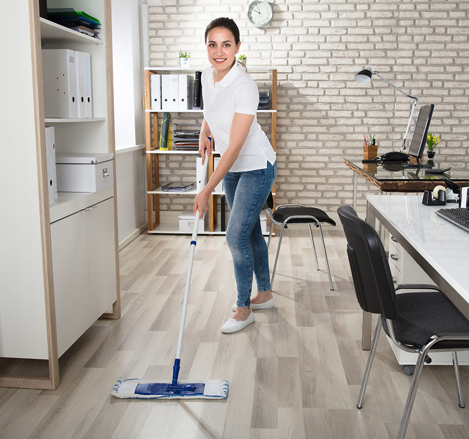 image of woman cleaning hardwood floor in living room